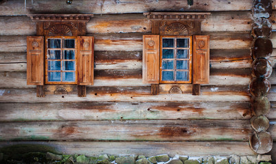 windows of a log cabin