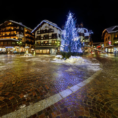 Fotomurales - Illuminated Central Square of Madonna di Campiglio in the Evenin