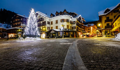 Fototapete - Illuminated Central Square of Madonna di Campiglio in the Mornin