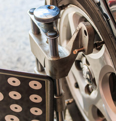 Car wheel fixed with computerized wheel alignment clamp