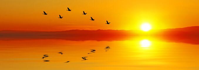 Obraz puesta de sol sobre el agua - fototapety do salonu