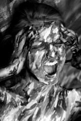 Emotional woman in paint strokes