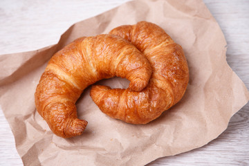 Two croissants on eco paper