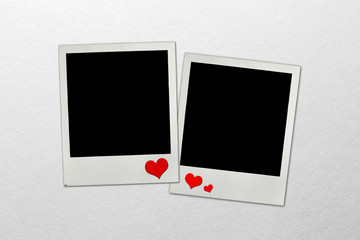 Photo frames on paper background with paper hearts