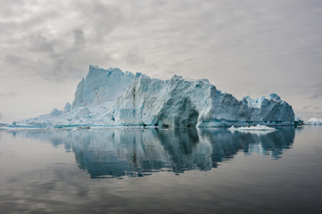 Reflection of icebergs in Disko bay, North Greenland