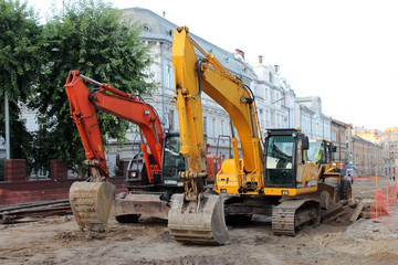 two modern excavators working on the Lvov's street