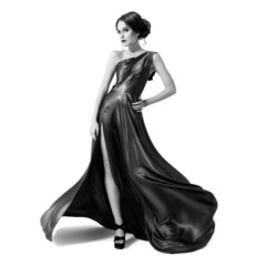 Fashion woman in fluttering dress. Black and white image. Isolat