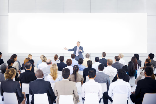 Large group of business people in presentation.