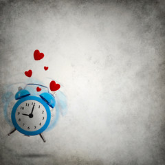 Vignette grungy background with love ringing clock and hearts
