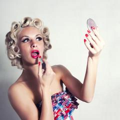 girl preens in the mirror