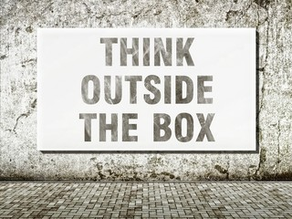 Think outside the box, words on wall