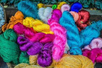 colorful silk yarns Jim Thompson House museum bangkok thailand