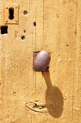 Wooden door with metal knob
