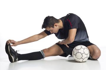 junger Mann Fussballer beim Aufwärmen