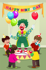 Clown carrying balloons to kids birthday party
