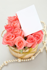 pink rose with paper note