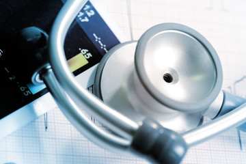 Stethoscope and medical papers