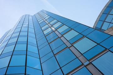 Tuinposter Aan het plafond Modern building against blue sky