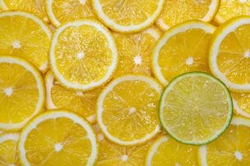 Alone lime amid lemons.
