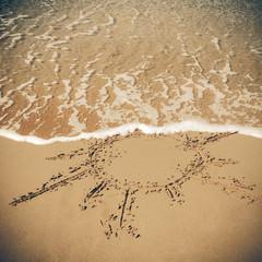 Sun drawn on the sandy beach. Vintage Coaster