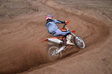 Entrance to turn the sandy track racer of motocross motorcycle w