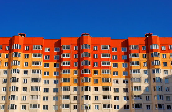 Low angle view of brightly colored apartment building