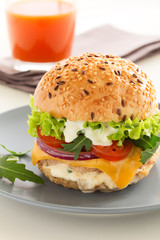 Burger with meat and vegetables.