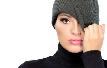 Beautiful Winter Girl Hiding Eye with Cap. Spy