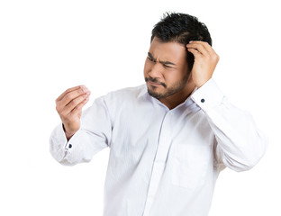 Unhappy, worried man losing hair