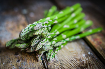 Wall Mural - Asparagus on rustic wooden background