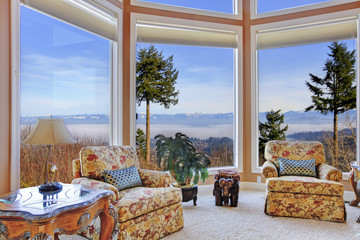 Amazing rich interior with stunning window view on mountains
