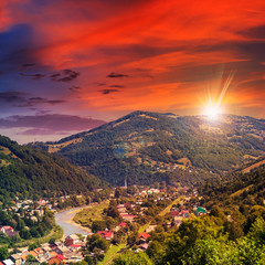 village near the river to forest in mountain at sunset