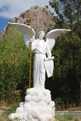 white angel with cross