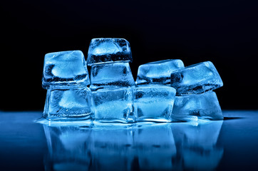 Ice cubes of  blue color on a black background