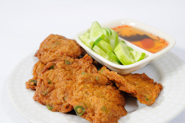 fried fish cakes with cucumber sauce.