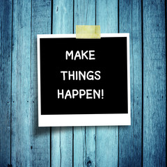 MAKE THINGS HAPPEN mesaage on  photo on grunge wooden background