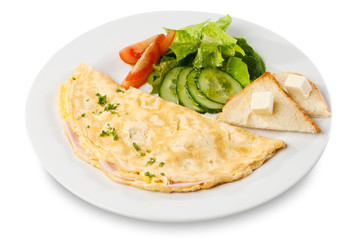 Omelette with ham, tomato and cucumber