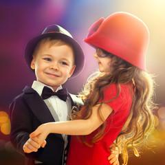 Lovely little boy and girl dancing