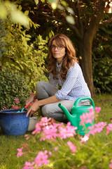 Beautiful woman in her garden