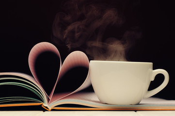 Cup of coffee with book on valentines day