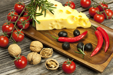 piece of natural cheese on a wooden board