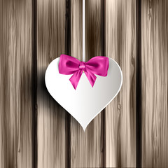 Abstract heart on wooden background