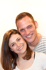Portrait of a happy young Caucasian couple smiling