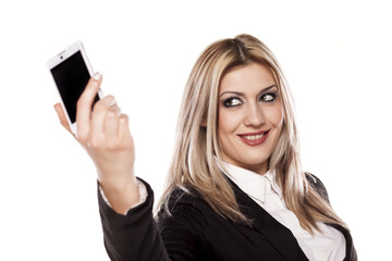 pretty business woman taking selfie with her smart phone