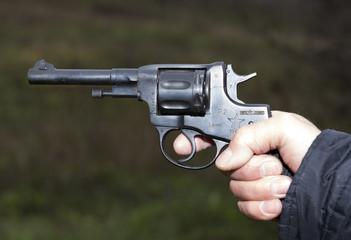 Pistol Nagant revolver in hand gangster