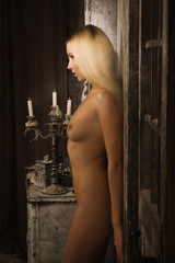Naked girl in a mystical interior