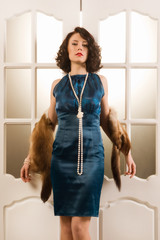 Brunette model dressed up in retro clothing