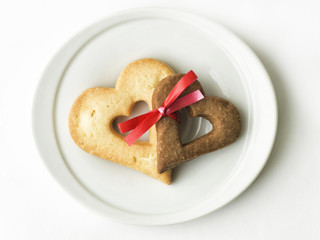 two heart-shaped cookies tied together