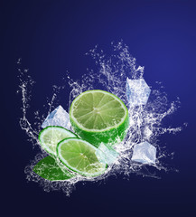 Sliced lime with ice pieces in water drops