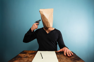 Man with bag over head comitting suicide
